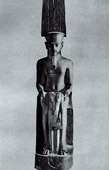 Ancient Egypt - Egyptology - The Egyptian Art - Sculpture - Statue of the God Amun Protecting Tutankhamun